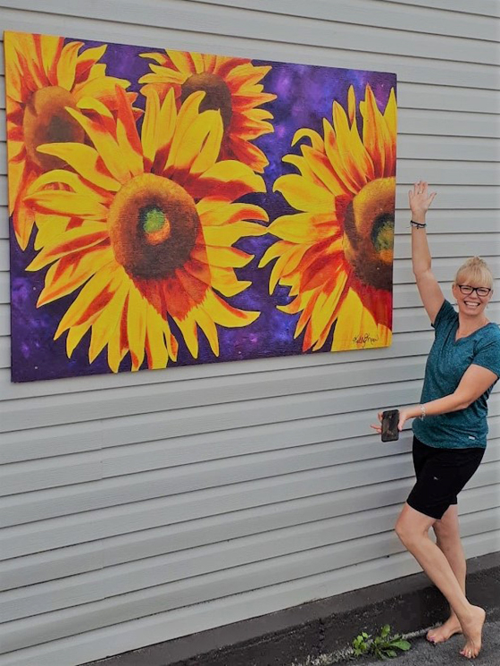 Kelly-and-Big-Sunflower-Sign-kellymaw.com-The-Mat--The-Easel-paint-lessons-yoga-lessons