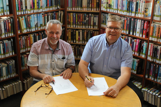 Library-Board-Chairs-Sign-New-Agreement